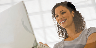 A smiling woman at a computer